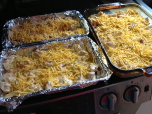 Ready for the oven. 2 Smaller casseroles for delivery & 1 portion for us.