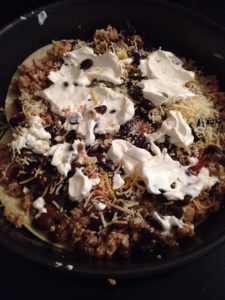 Taco meat (1/2 of what I cooked), black beans (yummy), salsa, cheese, sour cream and salsa verde.