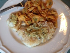 Pan-Seared Cod with Mustard Caper Sauce, served alongside Gluten-Free Spinach Tortellini